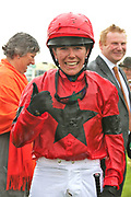 INSTANT ATTRACTION (1) ridden by Charlotte Atkinson and trained by Jedd O'Keeffe wins The Ernest Cooper Macmillan Ride Of Their Lives Charity Race over 1m 1f and the jockey gives the thumbs up during the MacMillan Charity Raceday held at York Racecourse, York, United Kingdom on 15 June 2019.