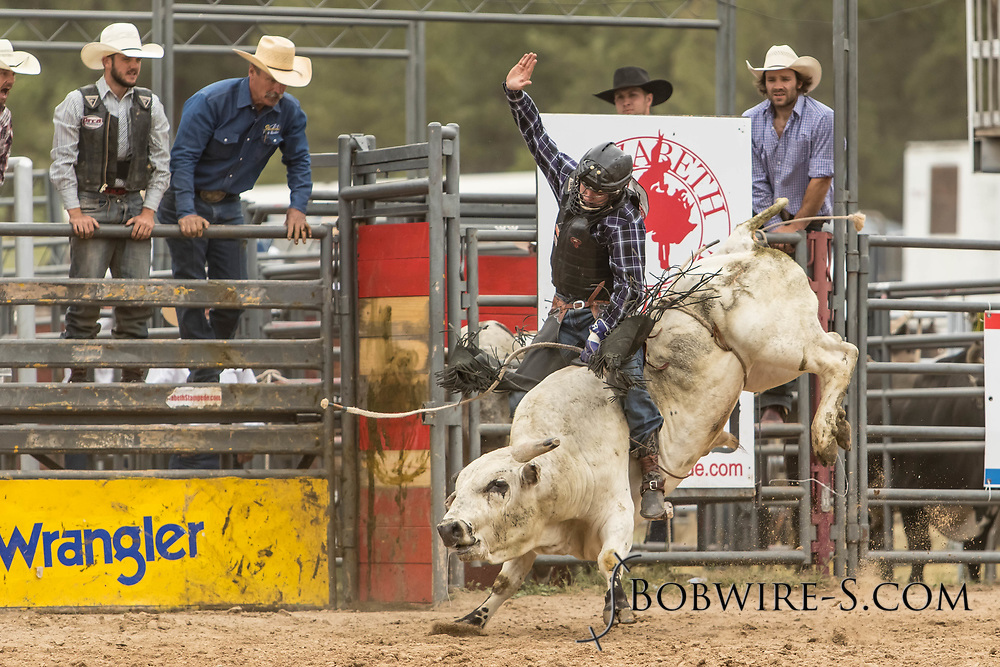 Bull rider Colten Beaty rides Summit Pro Rodeo's Kingsman during the third performance of the Elizabeth Stampede on Sunday, June 3, 2018.