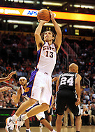 Nov. 3 2010; Phoenix, AZ, USA; Phoenix Suns guard Steve Nash (13) puts up a basket during the first half against San Antonio Spurs at the US Airways Center. Mandatory Credit: Jennifer Stewart-US PRESSWIRE.
