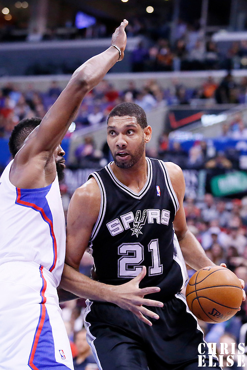 18 February 2014: San Antonio Spurs power forward Tim Duncan (21) drives past Los Angeles Clippers center DeAndre Jordan (6) during the San Antonio Spurs 113-103 victory over the Los Angeles Clippers at the Staples Center, Los Angeles, California, USA.