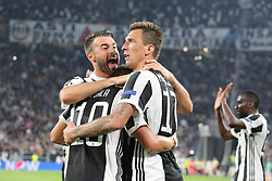September 27, 2017 - Turin, Piedmont, Italy - Mario Mandzukic (Juventus FC, left) celebrate after scoring with Andrea Barzagli Juventus FC, right) and Paulo Dybala (Juventus FC, center) during the UEFA Champions League (Group D) football match between Juventus FC and Olympiakos FC  at Allianz Stadium on 27 September, 2017 in Turin, Italy. .Juventus won 2-0 over Olympiakos. (Credit Image: © Massimiliano Ferraro/NurPhoto via ZUMA Press)