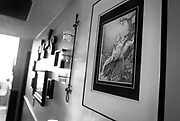 Some of Clint's artwork hangs on the wall in his Logan home, Monday, Jan. 14, 2013. In addition to receiving a culinary certification while in prison, Clint took up stipple painting to help pass the time and illustrate his faith.