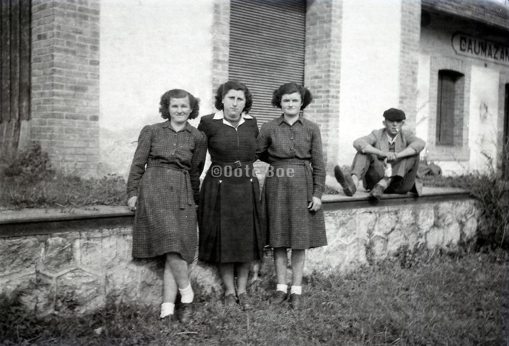 three girls posing outside the train station at Daumazan-sur-Arize France