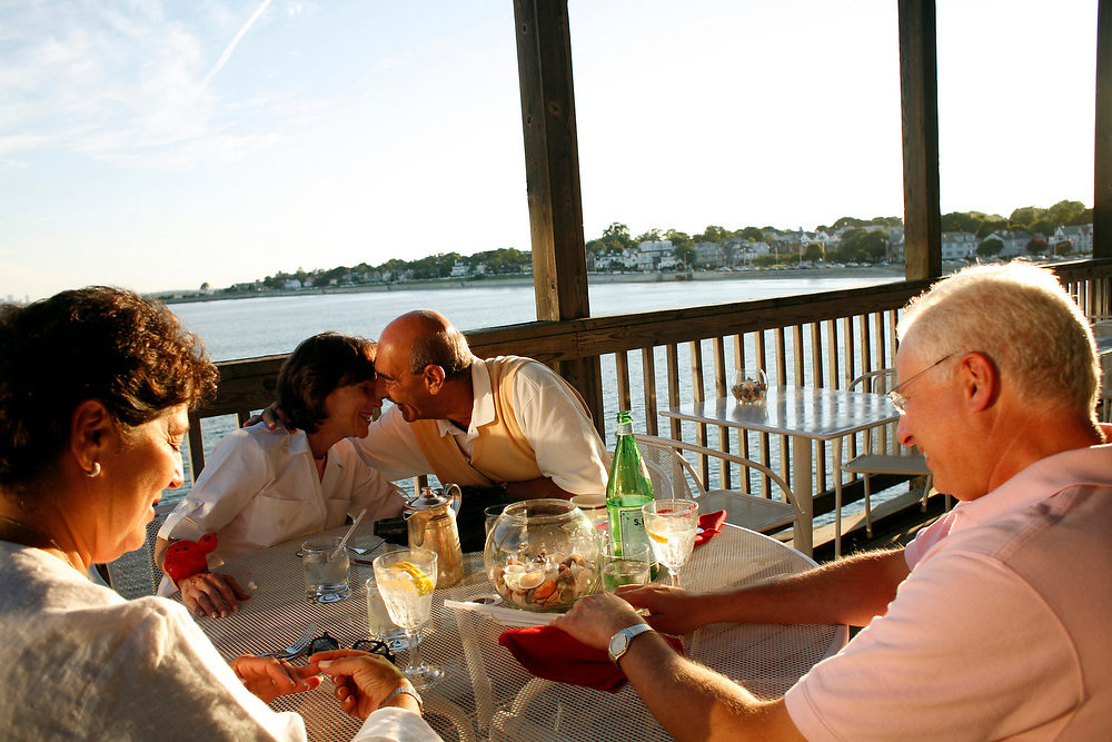 SWAMPSCOTT, MA--Jul 10, 2008--Anthony's Pier 4 patrons (from left) Robin Cooper, Beverly Bloch, Michael Kagan and Bob Cooper enjoy the view from the terrace...GLOBE PHOTO BY ZARA TZANEV