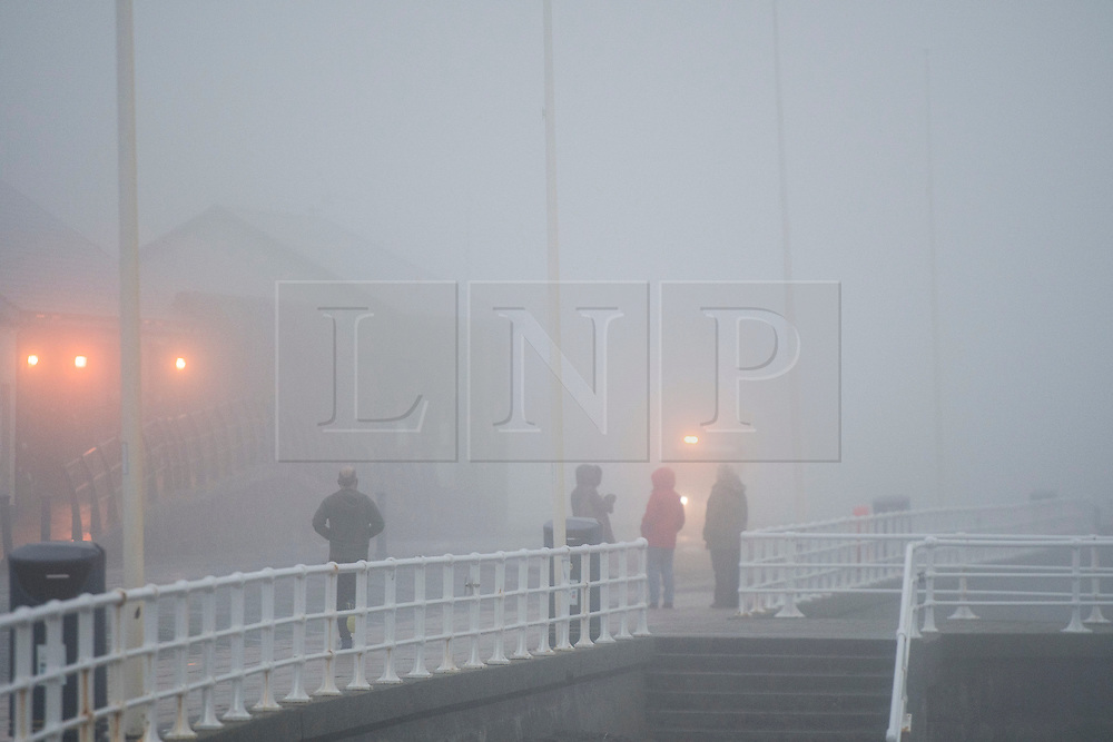 © London News Pictures. 08/01/2016. Aberystwyth, UK. Thick fog and and sea mist envelops the coastline Aberystwyth seafront at the start of the day on Sunday 8 Jan 2016. The mild damp weather is set to change later in the week with a plume of cold northerly  air bringing snow to many areas. Keith Morris/LNP