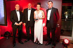 Wales' Angharad James is presented with the Women's Young Player of the Year Award by Fosters' Chris Middleton (L), FAW President Trefor Lloyd-Hughes (C) and Wales women's manager Jarmo Matikainen at the FAW Footballer of the Year Awards 2014. (Pic by David Rawcliffe/Propaganda)