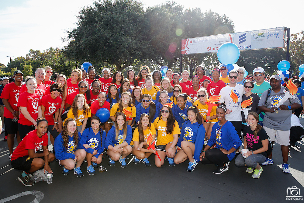 San Jose State University's women's basketball and gymnastics teams pose for a group photo during the 2014 Silicon Valley Heart & Stroke Walk at KLA-Tencor in Milpitas, California, on October 11, 2014. (Stan Olszewski/SOSKIphoto)