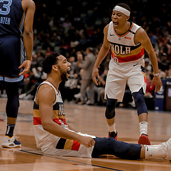 Jan 7, 2019; New Orleans, LA, USA; New Orleans Pelicans center Jahlil Okafor (8) reacts with guard Tim Frazier (10) and forward Anthony Davis (right) after a basket and foul during the fourth quarter against the Memphis Grizzlies at the Smoothie King Center. Mandatory Credit: Derick E. Hingle-USA TODAY Sports