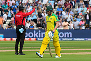 Wicket - Aaron Finch of Australia looks dejected as he walks back to the pavilion after being dismissed by Jofra Archer of England during the ICC Cricket World Cup 2019 semi final match between Australia and England at Edgbaston, Birmingham, United Kingdom on 11 July 2019.