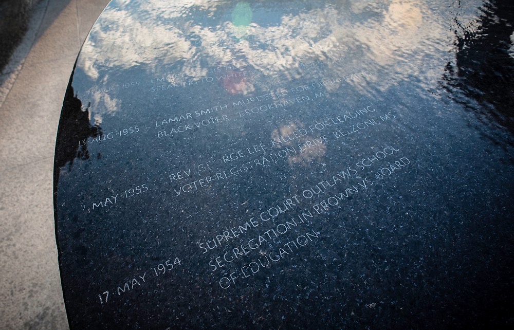 MONTGOMERY, AL -- 5/24/17 -- The sky is reflected in the Civil Rights Memorial commissioned by the Southern Poverty Law Center and dedicated in 1989. The memorial is the cornerstone of the Civil Rights Memorial Center which is housed in the former offices of the SPLC. <br /> Civil Rights attorney Morris Dees co-founded the Southern Poverty Law Center in 1971. The group has taken on the Ku Klux Klan and fought for against hate for decades, but is now facing criticism that it has labeled some groups without just cause..&hellip;by Andr&eacute; Chung #_AC17212
