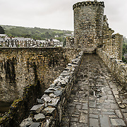 Parapets and ramparts at Harlech Castle in Harlech, Gwynedd, on the northwest coast of Wales next to the Irish Sea. The castle was built by Edward I in the closing decades of the 13th century as one of several castles designed to consolidate his conquest of Wales.
