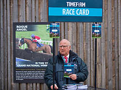 LIVERPOOL, ENGLAND - Thursday, April 6, 2017: a man sells race cards during The Opening Day on Day One of the Aintree Grand National Festival 2017 at Aintree Racecourse. (Pic by David Rawcliffe/Propaganda)