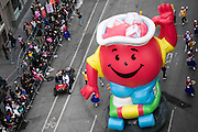 The Kool Aid balloon goes down 6th Avenue for the 89th annual Macy's Thanksgiving Day Parade as seen from above street level on Thursday, Nov. 26, 2015, in New York. (Photo by Ben Hider/Invision/AP)