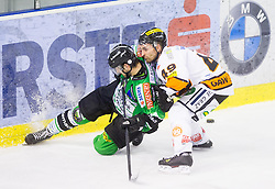 19.01.2014, Hala Tivoli, Ljubljana, SLO, EBEL, HDD Telemach Olimpija Ljubljana vs Moser Medical Graz 99ers, 2. Plazierungsrunde, in picture  Ziga Pesut (HDD Telemach Olimpija) and Greg Day (Graz 99ers) during the Erste Bank Icehockey League 2nd Placing round  between HDD Telemach Olimpija Ljubljana and Moser Medical Graz 99ers at the Hala Tivoli, Ljubljana, Slovenia on 2014/01/19. Photo by Vid Ponikvar / Sportida