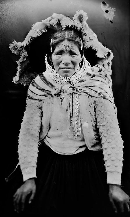 In this June 13, 2017 photo taken with a 19th century style box camera, Sebastiana Jara poses for a portrait in the Sinakara Valley, during the Qoyllur Rit'i festival. Sebastiana sells handicrafts and typical fabrics from the Cusco region at the Snow Star festival. The festival features a pilgrimage by local people to the sanctuary where a boulder features an image of Jesus Christ known as the Lord of Qoyllur Rit'i (pronounced KOL-yer REE-chee).