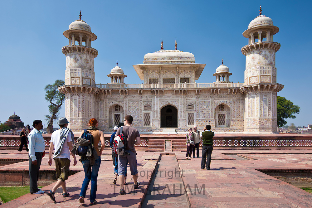 Tourists visit Tomb of Etimad Ud Doulah, 17th Century Mughal tomb built 1628, Agra, India