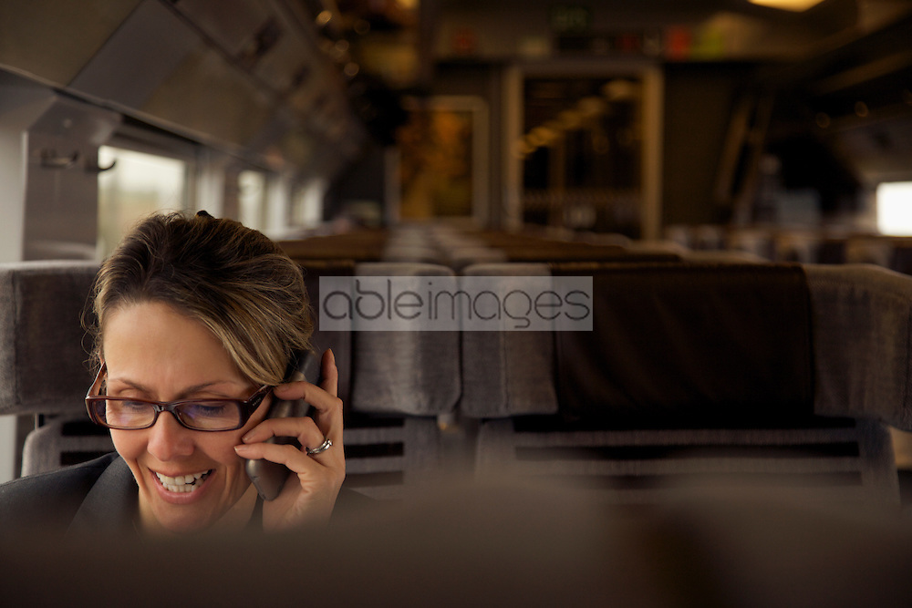 Woman on train using cell phone