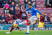 Jake Mulraney (#11) of Heart of Midlothian FC attempts to prevent Connor Goldson (#6) of Rangers FC from clearing the ball during the Ladbrokes Scottish Premiership match between Heart of Midlothian and Rangers FC at Tynecastle Park, Edinburgh, Scotland on 20 October 2019.