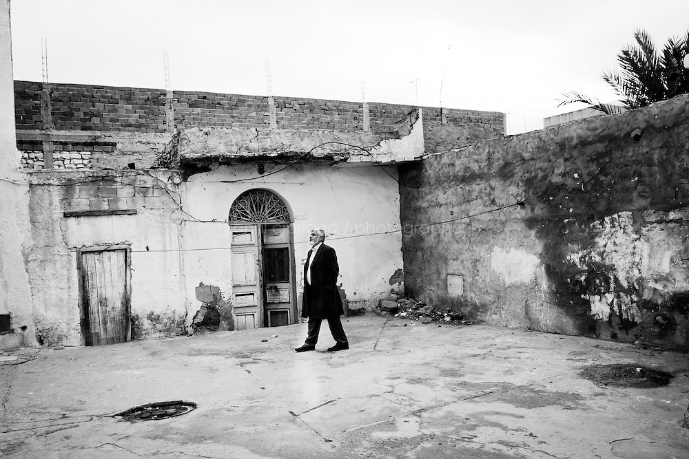 Kairouan, Tunisia - 18 December, 2011: Said Ferjani, 57, senior member of the political and communication bureau of the Nahda (Renaissance) party, walks next to his father's house who died in 2006 in Kairouan, Tunisia on 18 December, 2011. Said Ferjan's father died in Kairouan 2006 while Said was in exile in the UK since 1989. Said Ferjani started his activism in the Negra mosque of his hometown Kairouan when he was 16 years old, debating on politics, philosophy, economy and world events. In 1989 former dictator Zine El Abidine Ben Ali turned against Nahda (or Ennahda) and jailed 25,000 activists. Said Ferjani was jailed and tortured. He then flew Tunisia and moved to the UK. He came back to Tunisia after 22 years, after former dictator Ben Ali flew the country.<br /> <br /> Gianni Cipriano for The New York Times