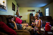 Leticia Hughes administers a Humira shot for her son Ashton, 12, at their Smiths Grove, Ky. home.  Humira costs have increased 85 percent over the last few years. (The Wall Street Journal)