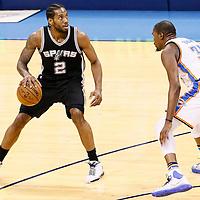 08 May 2016: Oklahoma City Thunder forward Kevin Durant (35) defends on San Antonio Spurs forward Kawhi Leonard (2) during the Oklahoma City Thunder 111-97 victory over the San Antonio Spurs, during Game Four of the Western Conference Semifinals of the NBA Playoffs at the Chesapeake Energy Arena, Oklahoma City, Oklahoma, USA.
