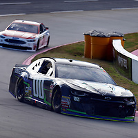 Joey Gase (00) races through turn three to practice  for the First Data 500 at Martinsville Speedway in Martinsville, Virginia.