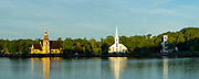 Sunrise view of the famous Mahone Bay Churches. From Left to right: St. James Anglican Church, St. John's Lutheran Church & United Church Mahone Bay. Mahone Bay, Nova Scotia, Canada.