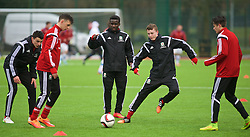 YSTRAD MYNACH, WALES - Thursday, February 19, 2015: Wales' Ibriam Sosani and Nathan Broadhead warm up before a friendly match against Czech Republic at the Centre of Sporting Excellence. (Pic by Carl Robertson/Propaganda)