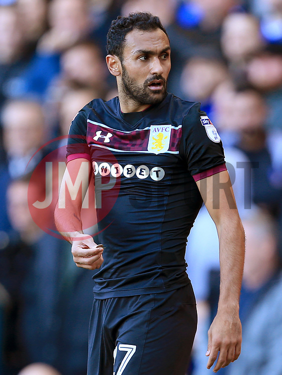 Ahmed Elmohamady of Aston Villa picks up a coin thrown by the Birmingham City support - Mandatory by-line: Paul Roberts/JMP - 29/10/2017 - FOOTBALL - St Andrew's Stadium - Birmingham, England - Birmingham City v Aston Villa - Skybet Championship