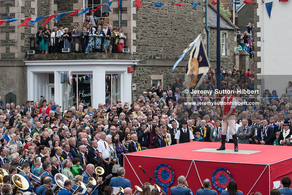 The Casting of the Colours ceremony, where the town's associations flags are waved in spectacular fashion in front of large crowds, led by Royal Burgh Standard Bearer Martin Rodgerson and his Burleymen, during the Common Riding festivities in Selkirk, in Selkirk, Scotland, Friday 14th June 2013.
