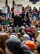 "15 MARCH 2019 - ST. PAUL, MINNESOTA, USA: A student stands in the middle of the crowd during the MN Youth for Climate Justice ""Climate Strike"" at the Minnesota State Capitol in St. Paul, MN. Thousands of high school students braved below freezing temperatures and biting winds to demand action on climate change. The Minnesota Climate Strike was inspired by the strike by Greta Thunberg, a Swedish high school student, who started a climate strike at her school in August 2018.       PHOTO BY JACK KURTZ"