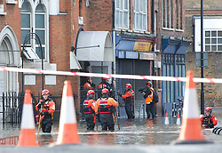 © Licensed to London News Pictures. 11/12/2016. LONDON, UK. Emergency services attend a flood scene in the junction of Northwold Road and Stoke Newington High Street, east London, after a pipe burst on Sunday morning.  Photo credit: ISABEL INFANTES/LNP
