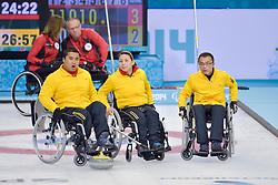 Haito Wang, Guangqin Xu, Qiang Zhang, Wheelchair Curling Semi Finals at the 2014 Sochi Winter Paralympic Games, Russia