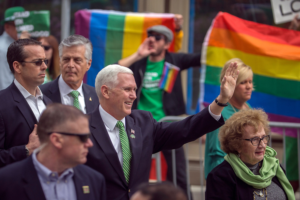 Vice President Mike Pence and his mother Nancy Pence Fritsch, right, wave while walking in the St. Patrick's Day parade Saturday, March 17, 2018, in Savannah, Ga. Irish immigrants to Savannah and their descendants have been celebrating St. Patrick's Day with a parade since 1824. (AP Photo/Stephen B. Morton)