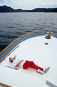 Tour guide having a siesta during excursion to Topolobampo Bay, Los Mochis.