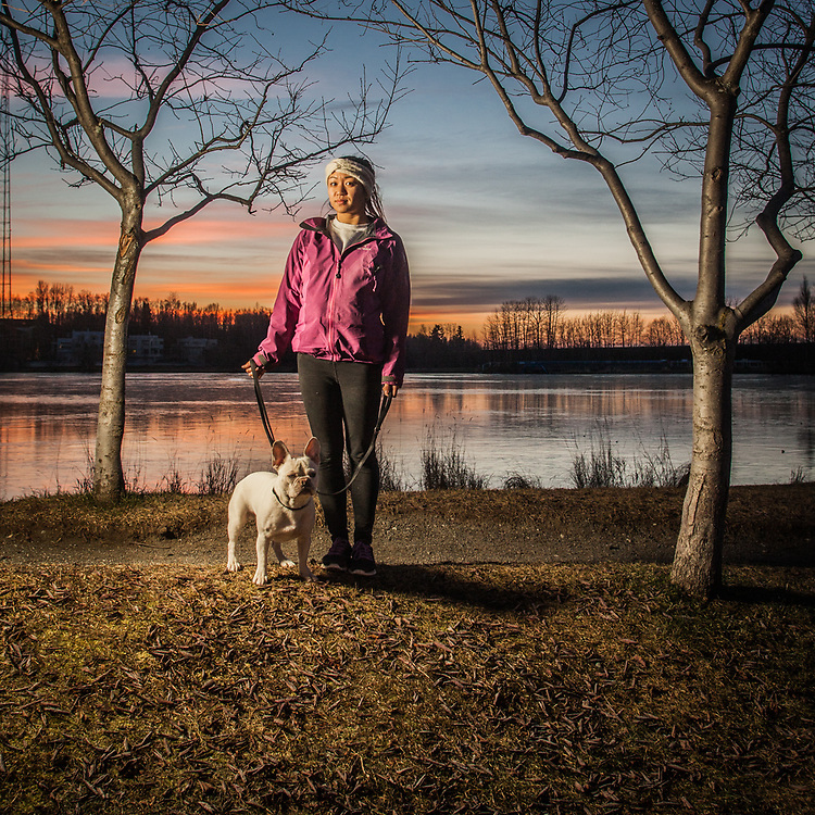 """""""I'm really looking forward to a long run but Milo is not so excited about it""""  -UAA accounting student Annie Nguyen and her French Bull Dog, Milo, at Westchester Lagoon, Anchorage"""
