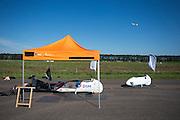 De twee bodies van de VeloX2 staan klaar om geprepareerd te worden. Het Human Power Team Delft en Amsterdam, bestaande uit studenten van de TU Delft en de VU Amsterdam, trainen op de RDW baan in Lelystad voor de laatste keer voor de recordpoging. In september wil het team met Jan Bos en Sebastiaan Bowier het snelheidsrecord op de fiets te verbreken. Dat record staat nu op 133 km/h.<br /> <br /> The old (left) and new body for the VeloX2. Human Power Team Delft and Amsterdam are having the last training for the record attempt in Battle Mountain (USA) at the RDW test track in Lelystad. The team will try to break the world speed record with a human powered vehicle with riders Jan Bos and Sebastiaan Bowier. The record is now at 133 km/h..