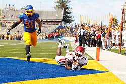 September 24, 2011; San Jose, CA, USA;  New Mexico State Aggies running back Kenny Turner (3) catches a pass for a touchdown past San Jose State Spartans linebacker Keith Smith (31) during the second quarter at Spartan Stadium.