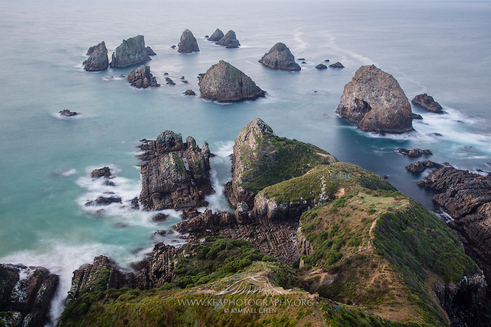 Rugged and rocky headlands butting into the ocean at Nugget Point, Catlins, New Zealand