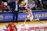 Golden State Warriors guard Klay Thompson (11) pushes the ball down the court against the Houston Rockets at Oracle Arena in Oakland, Calif., on October 17, 2017. (Stan Olszewski/Special to S.F. Examiner)
