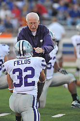 Oct 14, 2010; Lawrence, KS, USA; Kansas State Wildcats head coach Bill Snyder shakes hands with cornerback Roman Fields (32) before the game against the Kansas Jayhawks at Memorial Stadium. The Jayhawks won 59-7.  Mandatory Credit: Denny Medley-US PRESSWIRE