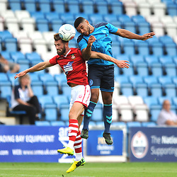 21/7/2018 - Ellis Deeney of AFC Telford battles for the ball with Chris Holroyd during the pre season friendly fixture between AFC Telford United and Wrexham at the New Bucks Head Stadium, Telford.<br /> <br /> Pic: Mike Sheridan/Newsquest NW<br /> MS173-2018