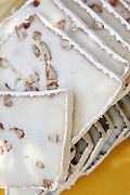 Slices of goat milk cheese with nuts