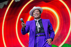© Licensed to London News Pictures . 09/08/2015 . Siddington , UK . KID CREOLE performs . The Rewind Festival of 1980s music , fashion and culture at Capesthorne Hall in Macclesfield . Photo credit: Joel Goodman/LNP