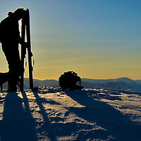 man and dog skier silhouettes
