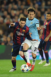 Barcelona's Lionel Messi challenges for the ball with Manchester City's David Silva - Photo mandatory by-line: Dougie Allward/JMP - Mobile: 07966 386802 - 18/03/2015 - SPORT - Football - Barcelona - Nou Camp - Barcelona v Manchester City - UEFA Champions League - Round 16 - Second Leg