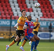 Newport County player Aaron Collins and Dagenham midfielder Andre Boucaud compete for a high ball during the Sky Bet League 2 match between Dagenham and Redbridge and Newport County at the London Borough of Barking and Dagenham Stadium, London, England on 19 September 2015. Photo by Bennett Dean.