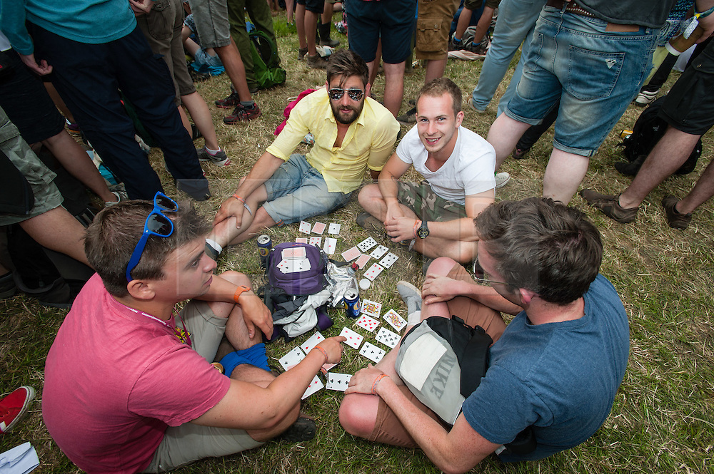 © Licensed to London News Pictures. 26/06/2015. Pilton, UK.  Festival atmosphere at Glastonbury Festival 2015 on Friday Day 3 of the festival.  This years headline acts include Kanye West, The Who and Florence and the Machine, the latter being upgraded in the bill to replace original headline act Foo Fighters.   Photo credit: Richard Isaac/LNP