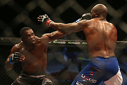 Dalcha Lungiambula (Blue) throws a punch at Tumelo Maphutha (Red) during the Interim Light Heavyweight Title bout of the Extreme Fighting Championships, EFC 52 held at the Grand West Casino in Cape Town, South Africa on the 5th August 2016<br /> <br /> Photo by:   Shaun Roy / Real Time Images