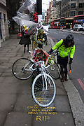 Roadside memorial to cycle courier Henry Warwick, killed in an accident on the junction of Bishopsgate and Wormwood Street.